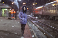 girl winter night in the city - at the railway station